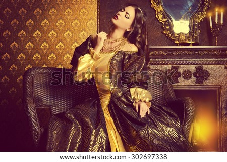 Renaissance Style -  beautiful young woman in the lush expensive dress in an old palace interior. Vintage style. Fashion. #302697338