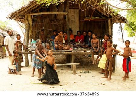 RENARD ISLANDS, PNG - JULY 16: Unidentified melanesian people of Papua New Guinea. July 16, 2009, Bwagaoia, Misima Island, Papua New Guinea