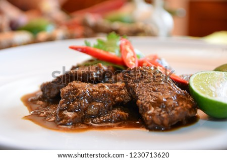 Rendang Padang beef, Spicy beef stew from Padang, Indonesia food. The popular Padangnese or West Sumatran dish of spicy beef stew