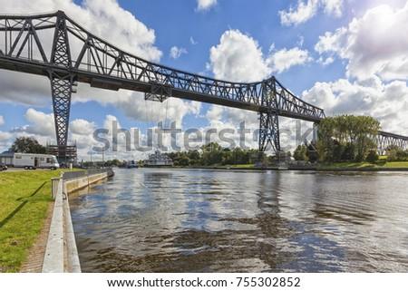 Rendsburg high bridge with suspension ferry crossing the Kiel Canal