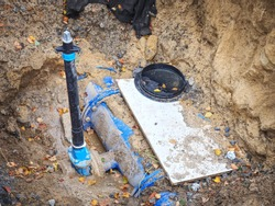 Reneval potable water system in the city. Laying plastic water pipes at the corner of a flat house