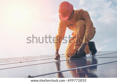 Renewable energy and solar power concept, worker or Electrical engineers are checking and training installing  photovoltaic plant in solar power station alternative energy from nature