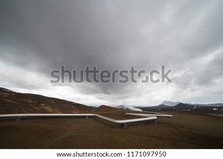 Renewable geothermal energy pipeline. Natural source of heat and electricity. Steam station in Iceland