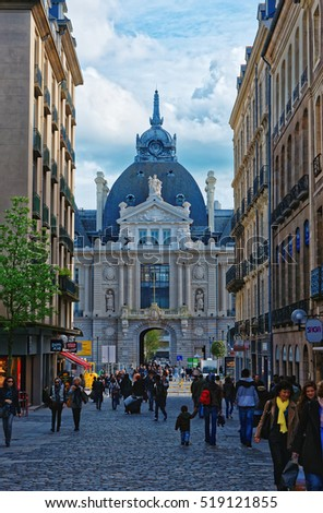 Rennes, France - May 7, 2012: Palace of Commerce and Orleans shopping street in the city center of Rennes, Brittany region of France. People on the background