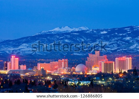 RENO - FEBRUARY 2: Reno skyline on February 3, 2013. It's known as The Biggest Little City in the World, famous for it's casinos and is the birthplace of the gaming corporation Harrah's Entertainment. - stock photo