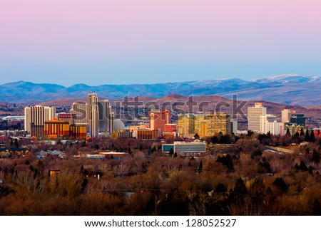 RENO - FEBRUARY 9: Reno skyline on February 9, 2013. It's known as The Biggest Little City in the World, famous for it's casinos and the birthplace of the gaming corporation Harrah's Entertainment.