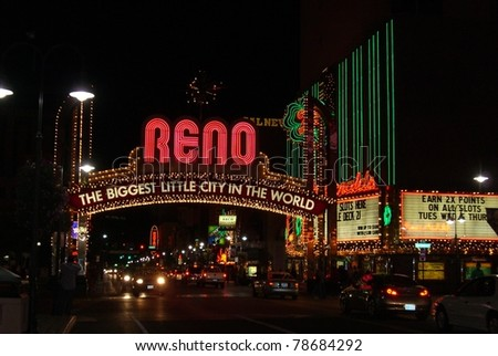 RENO - SEPTEMBER 20: Reno Arch neon sign at night on famous Virginia Street on September 20, 2008 in Reno, NV. Installed in 1987, it contains 2,076 incandescent energy efficient 2.5 watt LED bulbs.