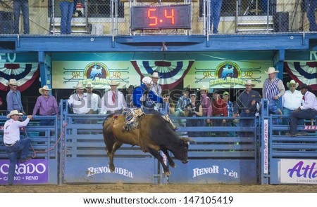 RENO , USA - JUNE 30 : Cowboy Participant in a Bull riding Competition at the Reno Rodeo  a Professional Rodeo held in Reno Nevada , USA on June 30 2013