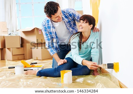 renovation diy paint couple in new home painting wall