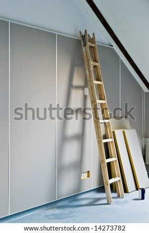 renovation - ladder and construction materials indoors