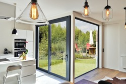 Renovation on a Modern luxury kitchen  with sliding door and view on a lush garden