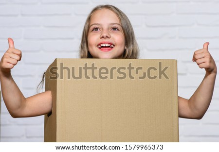 Rent house. Real estate. Kid moving out. Moving routine. Prepare for moving. Make moving easier. Girl small child carry cardboard box. Packaging things. Move out concept. Delivering your purchase. #1579965373