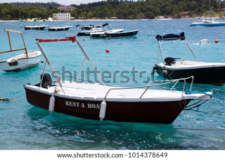 Rent motor boat for summer vacation trip to exotic tropical islands.Rental yachts drifting in beautiful blue sea.Beautiful travel destination on Adriatic Sea.Crystal clear water.Rent water craft boat