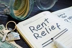 Rent relief sign and almost empty jar with money.
