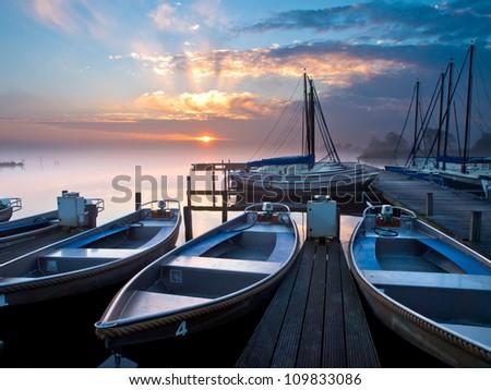 Rental boats in an marina during sunrise