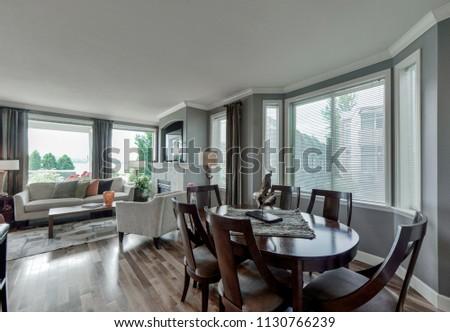 Renton, WA / USA - July 6, 2018: Modern dining room and living room interior #1130766239