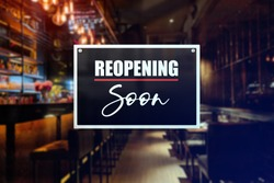 Reopening sign of a bar or pub. Concept of business recovery, temporary closure or lifting of restrictions.