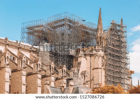 Repair and reconstruction work on the reconstruction of Notre Dame after the fire - scaffolding around the facade