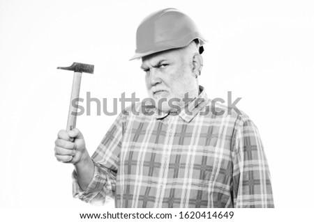 Repair concept. Senior foreman worker. Handyman home repair. Experienced engineer. Repairing or renovating. Home improvement repair. Man bearded laborer wear helmet hold hammer. Repair workshop.
