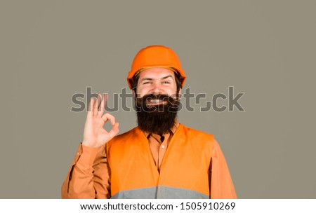 Repair, construction, building. Male builder or manual worker in helmet shows ok sign. Mechanical worker making gesture okay. Construction worker in hard hat. Bearded man in hardhat with perfect sign. Stock photo ©