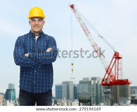 repair, construction, building, people and maintenance concept - smiling male builder or manual worker in helmet over city construction site background