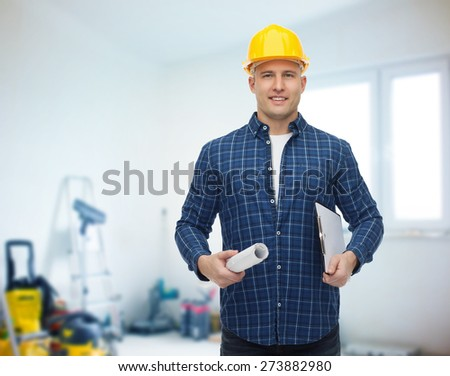 repair, construction, building, people and maintenance concept - smiling male builder or manual worker in helmet with blueprint and clipboard over room with work equipment background
