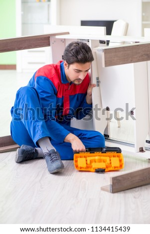Repair contractor repairing broken furniture at home #1134415439