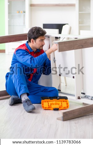 Repair contractor repairing broken furniture at home #1139783066