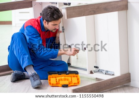 Repair contractor repairing broken furniture at home #1155550498