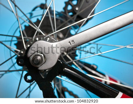 repair of a bicycle with a metal wrench