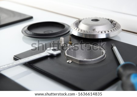 Repair of a gas burner on a glass hob.Gas Stove Repair & Services.Gas stove Repair and maintenance of electrical equipment.Gas leak.