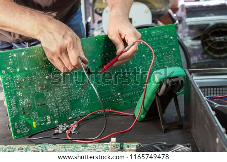 Repair of a power supply unit in the service center, fault diagnosis by measuring devices.