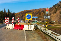 repair of an automobile bridge across the Bolshoi Inzer river on the Beloretsk Ufa highway on a sunny autumn day. Russian text: big Inzer, stop.