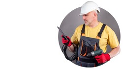 Repair of household appliances. Maintenance mobile app. Repairman with a smartphone. Man dressed as a repairman is holding a phone. Place for an inscription. Repairman search applications.