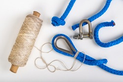 Repair of sailing ropes and slings. Sailor accessories. Light background.