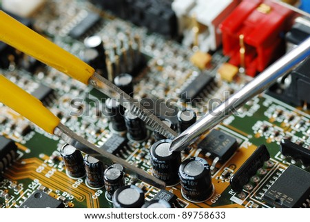Repair of the circuit board in a computer - stock photo