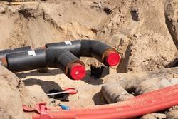 Repair of water pipes, excavated sidewalk, sectional pipes