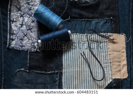 Repair your favorite jeans re-use to see cool. Foto stock ©