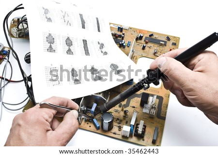 Repairing circuit board - stock photo