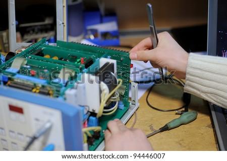 Repairing of microcircute of medical equipment with a help of tweezers