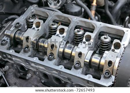Repairing of modern diesel engine closeup of camshaft and valves #72657493