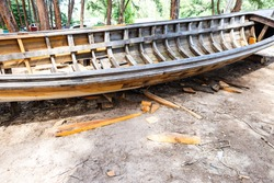 Repairing old wooden boat, traditional Thai style boat, outdoor day light, Asian style boat