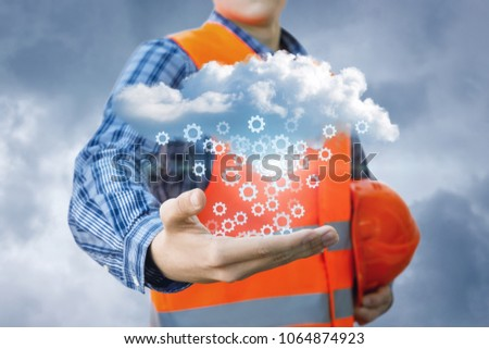 Repairman in the hands shows the process of setting up cloud data. #1064874923