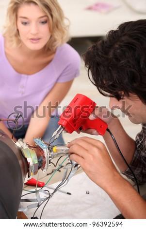 repairman repairing a television