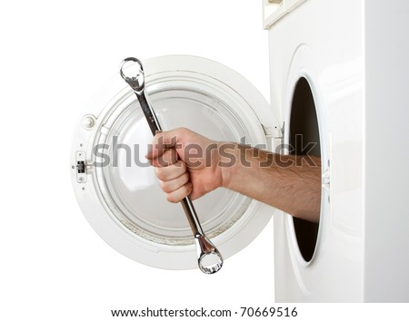 Repairman servicing washing machine. Isolated on white