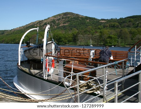 repairs being made on a tourist lake cruiser