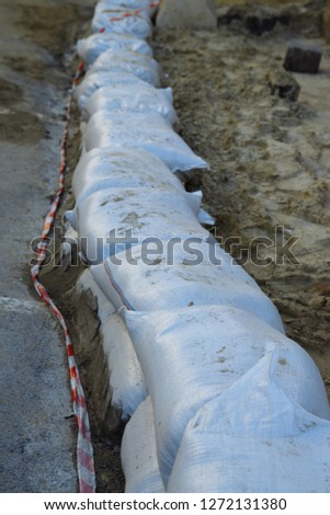 repairs.The wall of sandbags. sandbags wall, protection, flood
