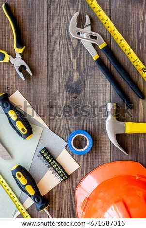 Reparing home concept. Tools on wooden desk background top view copyspace #671587015