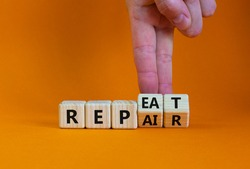 Repeat and repair symbol. Businessman turns wooden cubes and changes the word 'repeat' to 'repair'. Beautiful orange table, orange background, copy space. Business, repeat and repair concept.