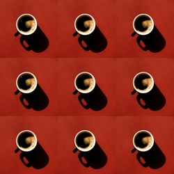 Repeating pattern of a cup full of coffee with harsh shadows on a vivid red background